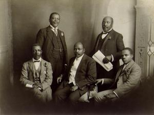 SANNC delegation that went to England to convey African people's objections to the 1913 Land Act, 1914. L-R: Rev W. Rubusana, T. Mapike, Rev J. Dube, S. Plaatjie and S. Msane. Courtesy of South Africa History Online.