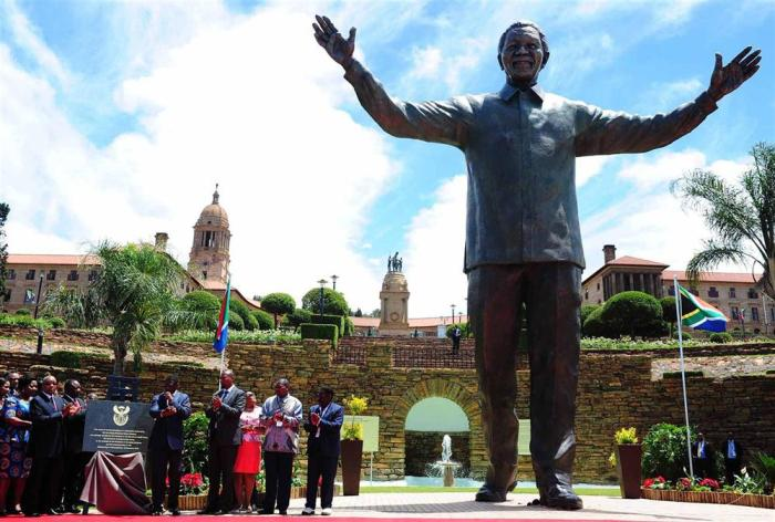 Towering above  his successor: How long before Nelson Mandela's long walk to economic freedom will end?